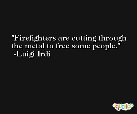 Firefighters are cutting through the metal to free some people. -Luigi Irdi